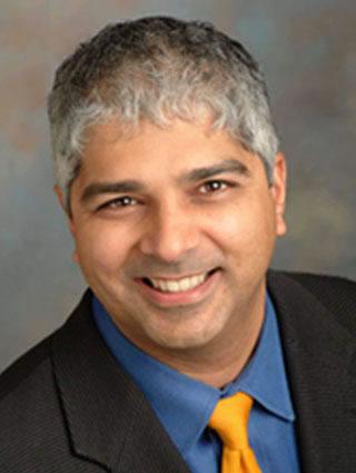 Dr. Tony Gill